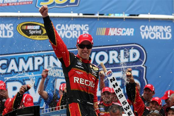 Photo Courtesy of: 299890Matt Sullivan/NASCAR via Getty Images. Brad Keselowski, driver of the #2 Redds Ford, celebrates in victory lane after winning the NASCAR Sprint Cup Series Camping World RV Sales 301 at New Hampshire Motor Speedway on July 13, 2014 in Loudon, New Hampshire.