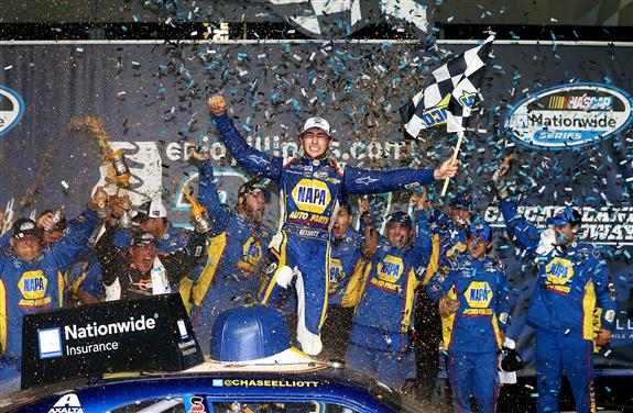 Photo Courtesy of: 300029Sean Gardner/NASCAR via Getty Images. Chase Elliott, driver of the #9 NAPA Auto Parts Chevrolet, celebrates after winning the NASCAR Nationwide Series EnjoyIllinois.com 300 race at Chicagoland Speedway on July 19, 2014 in Joliet, Illinois.