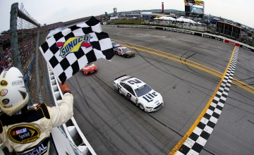 TALLADEGA, AL - MAY 01:  Brad Keselowski, driver of the #2 Miller Lite Ford, takes the checkered flag to win the NASCAR Sprint Cup Series GEICO 500 at Talladega Superspeedway on May 1, 2016 in Talladega, Alabama.  (Photo by Sarah Crabill/NASCAR via Getty Images)