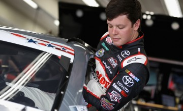 CHARLOTTE, NC - MAY 26:  Erik Jones, driver of the #20 GameStop Toyota, climbs into his car during practice for the NASCAR XFINITY Series Hisense 4K TV 300 at Charlotte Motor Speedway on May 27, 2016 in Charlotte, North Carolina.  (Photo by Streeter Lecka/Getty Images)