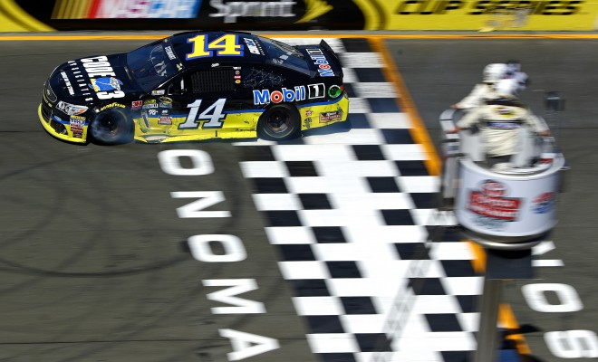 SONOMA, CA - JUNE 26:  Tony Stewart, driver of the #14 Code 3 Assoc/Mobil 1 Chevrolet, crosses the finish line to win the NASCAR Sprint Cup Series Toyota/Save Mart 350 at Sonoma Raceway on June 26, 2016 in Sonoma, California.  (Photo by Ezra Shaw/Getty Images)