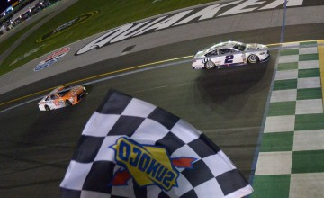 SPARTA, KY - JULY 09:  Brad Keselowski, driver of the #2 Miller Lite Ford, takes the checkered flag to win the NASCAR Sprint Cup Series Quaker State 400 at Kentucky Speedway on July 9, 2016 in Sparta, Kentucky.  (Photo by Drew Hallowell/NASCAR via Getty Images)