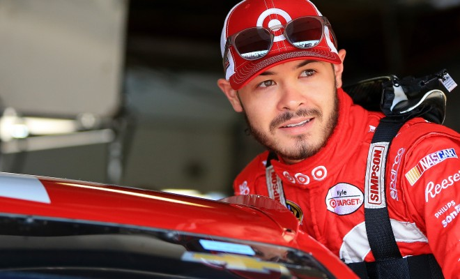 BROOKLYN, MI - JUNE 11:  Kyle Larson, driver of the #42 Target Chevrolet, climbs into his car during practice for the NASCAR Sprint Cup Series FireKeepers Casino 400 at Michigan International Speedway on June 11, 2016 in Brooklyn, Michigan.  (Photo by Daniel Shirey/NASCAR via Getty Images)