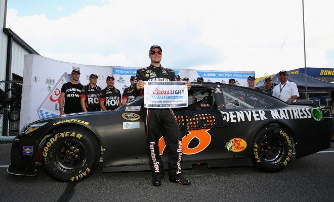 LONG POND, PA - JULY 29:  Martin Truex Jr, driver of the #78 Furniture Row Toyota, poses with the Coors Light Pole Award after qualifying for the NASCAR Sprint Cup Series Pennsylvania 400 at Pocono Raceway on July 29, 2016 in Long Pond, Pennsylvania.  (Photo by Adam Glanzman/Getty Images)