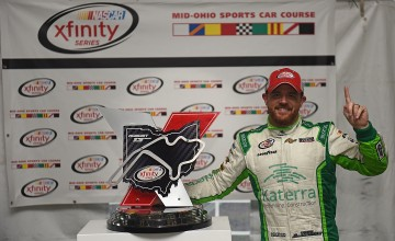 LEXINGTON OH - AUGUST 13: Justin Marks driver of the #42 Katerra Chevrolet celebrates in Victory Lane after taking first place in the 4th annual NASCAR XFINITY Series Mid-Ohio Challenge at Mid-Ohio Sports Car Course on August 13, 2016 in Lexington Ohio. (Photo by Jonathan Moore/Getty Images)