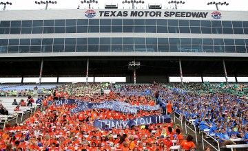 FORT WORTH, TX - MAY 24:  Students of Old Settlers Elementary cheer during the Speeding To Read Championship Assembly at Texas Motor Speedway on May 24, 2016 in Fort Worth, Texas.  (Photo by Sarah Crabill/Getty Images for Texas Motor Speedway)