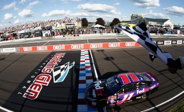 WATKINS GLEN, NY - AUGUST 07:  Denny Hamlin, driver of the #11 FedEx Freight Toyota, takes the checkered flag to win the NASCAR Sprint Cup Series Cheez-It 355 at Watkins Glen International on August 7, 2016 in Watkins Glen, New York.  (Photo by Jeff Zelevansky/NASCAR via Getty Images)