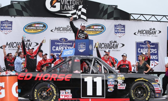 BROOKLYN, MI - AUGUST 27:  Brett Moffitt, driver of the #11 Red Horse Racing Toyota, celebrates in victory lane after winning the NASCAR Camping World Truck Series Careers for Veterans 200 at Michigan International Speedway on August 27, 2016 in Brooklyn, Michigan.  (Photo by Rey Del Rio/Getty Images)
