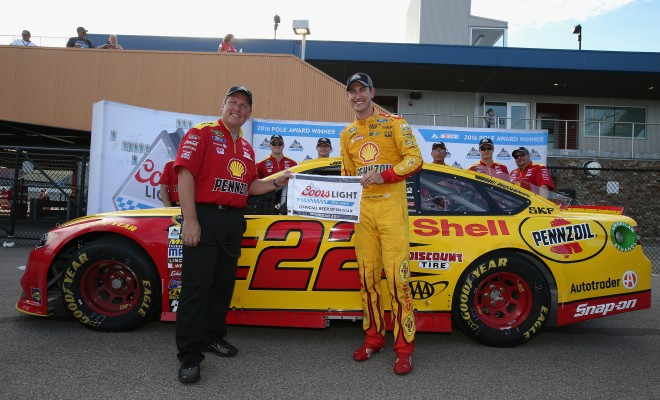 BROOKLYN, MI - AUGUST 26:  (L-R) Crew chief Todd Gordon and Joey Logano, driver of the #22 Shell Pennzoil Ford, pose with the Coors Light Pole Award after qualifying for the NASCAR Sprint Cup Series Pure Michigan 400 at Michigan International Speedway on August 26, 2016 in Brooklyn, Michigan.  (Photo by Sean Gardner/Getty Images)