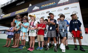 LONG POND, PA - AUGUST 02:  Pocono Raceway Kids Club Members say Drivers, Start Your Engines before the NASCAR Camping World Truck Series Pocono Mountains 150 at Pocono Raceway on August 2, 2014 in Long Pond, Pennsylvania.  (Photo by Todd Warshaw/NASCAR via Getty Images)