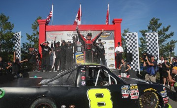 BOWMANVILLE, ON - SEPTEMBER 04: John H Nemechek, driver of the #8 NEMCO Motorsports Chevrolet, celebrates his win at victory lane with his crew at Canadian Tire Motorsport Park on September 4, 2016 in Bowmanville, Canada. (Photo by Tom Szczerbowski/NASCAR/NASCAR via Getty Images)