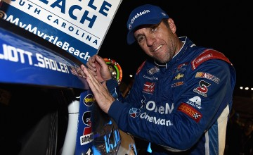 SPARTA, KY - SEPTEMBER 24:  Elliott Sadler, driver of the #1 OneMain Chevrolet, places the winner's decal on his car in Vicotry Lane after winning the NASCAR XFINITY Series VisitMyrtleBeach.com 300 at Kentucky Speedway on September 24, 2016 in Sparta, Kentucky.  (Photo by Jonathan Moore/NASCAR via Getty Images)