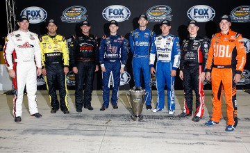 JOLIET, IL - SEPTEMBER 16:  (L-R)Timothy Peters, driver of the #17 Red Horse Racing Toyota, Matt Crafton, driver of the #88 Fisher Nuts/Menards Toyota, Johnny Sauter, driver of the #21 Alamo Chevrolet, William Byron, driver of the #9 Liberty University Toyota, Ben Kennedy, driver of the #33 Weber Chevrolet, Daniel Hemric, driver of the #19 Draw-Tite Ford, John H Nemechek, driver of the #8 TeamTurtle/TeamFoot Chevrolet, and Christopher Bell, driver of the #4 JBL Toyota, pose with the NASCAR Camping World Truck Series trophy after the NASCAR Camping World Truck Series American Ethanol E15 225 at Chicagoland Speedway on September 16, 2016 in Joliet, Illinois.  (Photo by Brian Lawdermilk/NASCAR via Getty Images)