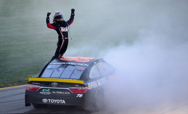 JOLIET, IL - SEPTEMBER 18:  Martin Truex Jr, driver of the #78 Furniture Row/Denver Mattress Toyota, celebrates after winning the NASCAR Sprint Cup Series Teenage Mutant Ninja Turtles 400 at Chicagoland Speedway on September 18, 2016 in Joliet, Illinois.  (Photo by Robert Laberge/Getty Images)