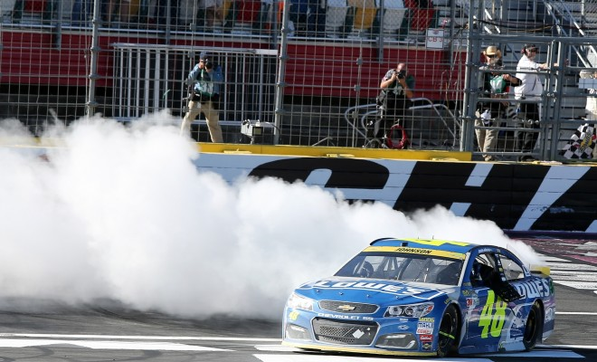 CHARLOTTE, NC - OCTOBER 09:  Jimmie Johnson, driver of the #48 Lowe's Chevrolet, celebrates with a burnout after winning the NASCAR Sprint Cup Series Bank of America 500 at Charlotte Motor Speedway on October 9, 2016 in Charlotte, North Carolina.  (Photo by Jerry Markland/NASCAR via Getty Images)