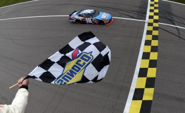 KANSAS CITY, KS - OCTOBER 15:  Kyle Busch, driver of the #18 NOS Energy Drink Toyota, crosses the finish line to win the NASCAR XFINITY Series Kansas Lottery 300 at Kansas Speedway on October 15, 2016 in Kansas City, Kansas.  (Photo by Rainier Ehrhardt/NASCAR via Getty Images)